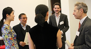 EEMI's Tian Peng, left, and Joe Cascio, right, discuss issues with other IFCE participants.